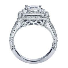 14K White Gold 2.25cttw Double Halo Princess Cut Diamond Engagement Ring. This classic style ring features .96cttw of round diamonds bead set in a double halo w