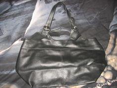 Musta peruslaukku neppari kiinnityksellä.Hinta:1e