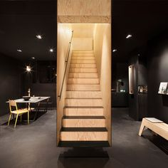 Box-like staircase forms a centrepiece inside Bazar Noir concept store, Interior design studio Hidden Fortress Floating Staircase, Modern Staircase, Staircase Design, Staircase Ideas, Interior Stairs, Interior Architecture, Dezeen Architecture, Retail Interior, Concept Store Berlin