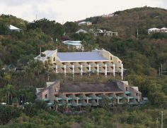 Metal DOES Make a Difference... Check out the astonishing difference between the building with the original cedar shakes and the villa recently re-roofed with PAC's Snap Clad standing seam metal roofing on the island of St John in the Virgin Islands, at the Westin Resorts Properties.