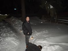 pic 91f.  This is how much snow we had that year.  Matt and Mike outside Christmas Day 2004.