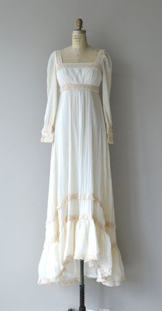 Vintage 1970s cream cotton gauze dress with darker cream crochet trim, empire waist, square neckline, lace cuffs and back zipper. --- M E A S U R E M