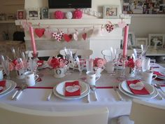 My Valentine Dinner Party table setting this weekend Feb 9th, 2013. Made the garland, too!  :)  By Katia E. Siders.
