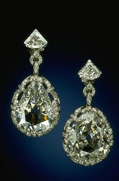 The two large pear shaped diamonds were supposedly set in earrings owned by Marie Antoinette who was guillotined in 1793. After they were taken from her, they remained in the  French Royal Family. In 1887 all the royal jewels were sold. These earrings went to Pierre Cartier who sold them to Marjorie Merriweather Post in 1928 after he replaced the tops of the earrings with triangular diamonds set in platinum. They were donated to the Smithsonian, in 1964 by Marjorie's daughter...