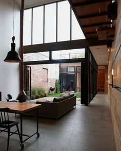 Concrete floor and timber panel wall