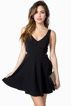 A textured skater dress featuring a plunging v-neck and a padded bust.