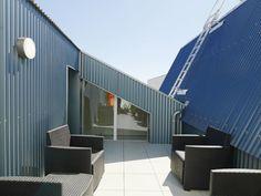 ANMA transformed marine hangars into a naturally-ventilated ho...