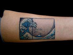 The Fibonacci spiral inside famous painting The Great Wave at Kanagawa by Hokusai, tattooed at Visionary Arts.