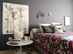 oversized botanical print + non-kitschy tapestry bedspread + Tulip-esque coffee table as nightstand