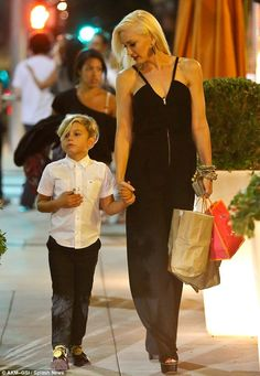 Successful night: The blonde carrying back gifts on her heavily embellished arm as she held hands with her eldest child