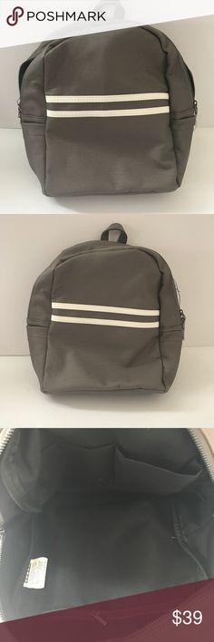 Gray Athletic Stripe Mini Backpack Trendy mini backpack. Two inside pockets and inside Zipper. Functional outside Zipper. Adjustable straps. Two outside mini pockets on each side. 10.5 inches tall. 11.5 inches wide. 5.5 inches deep. Approximate measurements. Material is polyeurethane. Only have ONE- will go fast! Bags Backpacks