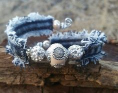 Items similar to Frayed Denim Cuff Bracelet with Glass Rondelle Beaded Flowers and Dangling Charms on Etsy Jewelry Crafts, Jewelry Art, Beaded Jewelry, Handmade Jewelry, Jewellery, Denim Bracelet, Bracelets, Textile Jewelry, Fabric Jewelry