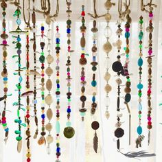 The bohemian suncatcher has three different lengths of the stick, 35 inches, 30 inches, and 15 inches. The 35 inch one includes 20 strands of beads.