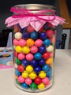 Gumballs in a mason jar. Hidden in the middle is half an empty toilet paper roll with money in it. Fill the jar half way, put in money roll and fill rest of jar with more gumballs.