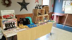Vendor Event display by Chris Hughes. We love the use of wood crates to create dimension.