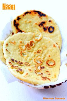 Kitchen Secrets: Naan (without Yeast All purpose flour -- 2 cups  Fresh  curd / yoghurt -- 1/2 cup  Milk , warm -- 1/2 cup  Sugar -- 1/2 tsp  Salt -- 1 tsp  Baking powder -- 3/4 tsp  Cooking soda / sodium bicarbonate -- 3/4 tsp  Butter -- 2 tsp