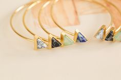 * 2016 F/W Season Jewelry Trend: Gemstone collection* Gemstone Triangle Bracelet-Your favorite ways to sparkle. Trending Stones-Turquoise; Opal; Moonstone; Pearl; Aquamarine;Blue Topaz ;Lapis Lazuli; Ruby. Over the centuries, various cultures have contributed to the legend and lore surrounding gemstones. These special minerals will make you more attractive with magical power !