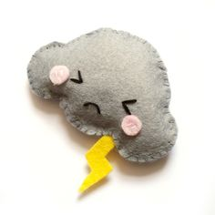 Adorable angry cloud brooch made out of Felt