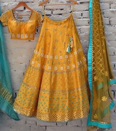 The beauty of Embroidery Work on the Yellow Banglori Silk fabric makes this lehenga a perfect Party Wear wear. Paired with Banglori Silk blouse this lehnga choli is sure to get you all the attention y. Lehenga Choli Designs, Lehenga Choli Online, Ghagra Choli, Sharara, Churidar, Half Saree Designs, Blouse Designs, Indian Wedding Outfits, Indian Outfits