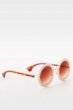 """Stay on top of the retro trend with the Moon Flower Sunglasses. These round frames feature golden flower details all around. <br> <br> - 2.25"""" lens width <br> - 2.25"""" lens height <br> - Imported <br>"""