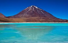 A place to visit in Bolivia is Laguna Verde.