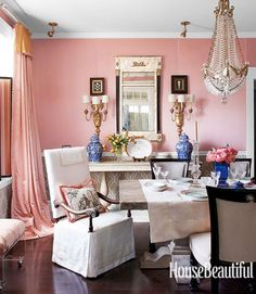 Cream & Coral: Feminine French Dining    Channel your inner Marie Antoinette with a soft pink and cream dining room. Pink silk drapes and walls create a warm and welcoming glow. Timeless French linen chairs with black and white toile pillows are an elegant and understated addition to the ornate setting. Photo via House Beautiful.