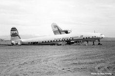 This TWA Super Constellation made a crash landing at NAS Fallon airbase's 7,000 foot runway during the early evening of December 7, 1952, photographed by Stan Kindig. The aircraft was severely damaged but, with only 699 hours of flight time, it was decided to repair it and a team from Lockheed was dispatched to Fallon. The aircraft reentered service with TWA on September 24, 1953 and served with the airline until leased to Worldwide Airlines in 1960.