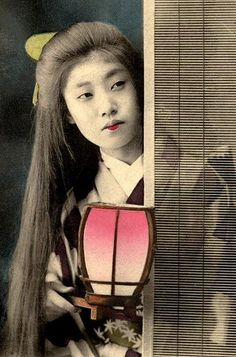 """Waiting for """"Big Sister"""" Geisha to Come Home. A geisha in training did not color her upper lip."""