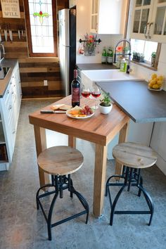 The kitchen includes a handmade movable island with cherry butcher block countertop, white farmhouse sink, full size refrigerator, electric cooktop, and dishwasher.