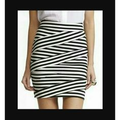 Express Black and White Bandage Skirt This skirt has only been worn twice and is in excellent like new condition. The skirt is missing the hook part of the skirt which is easily replaceable. The zipper is fully functional. Any questions just ask Express Skirts