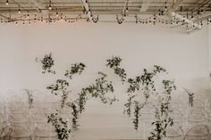 A classic white backdrop, ghost chairs, romantic twinkling lights and a splash of greenery - simplicity at its absolute finest💕 Photo Credit: Jennifer See Studios | Venue: District 28 | Florist: Rikki Marcone Events Ghost Chairs, White Backdrop, Twinkle Lights, Classic White, Photo Credit, Greenery, Wedding Ceremony, Backdrops, Studios