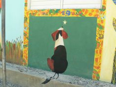 finishing up the school mural at Hugs for Kids school in Cangrejo. With Iesa and her mom.  The green behind the dog is a chalkboard for the kids to draw on.