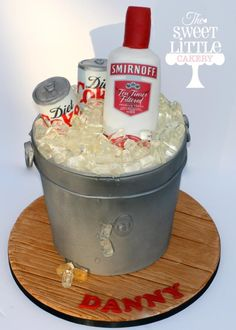 Ice bucket cake with vodka and diet coke made from rice krispie treats covered in sugar paste and edible icing sheet. The ice cubes are foxes mints. www.facebook.com/thesweetlittlecakery