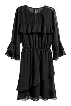 Dress in an airy weave with an opening and button at the back of the neck, flounced yoke at the front and 3/4-length sleeves with flounced cuffs. Seam at th