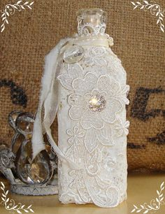Decorative Bottles : Vintage Bottle Embellished with Lace, Pearls and Rhinestones. Another great vintage wedding decoration idea… -Read More – Reuse Bottles, Vintage Bottles, Bottles And Jars, Glass Bottles, Vintage Perfume, Perfume Bottles, Wine Bottle Crafts, Jar Crafts, Bottle Art