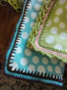 How to crochet finish a fleece blanket. Works better if you fold over the edge after cutting the holes. Makes it sturdier