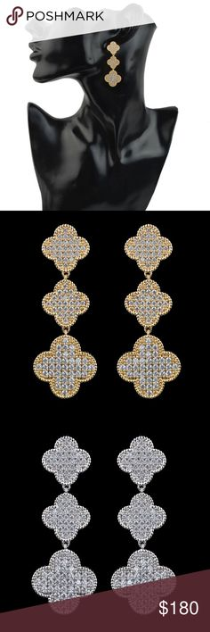 """Cubic Zirconia Earrings These elegant and breathtaking drops glisten and shimmer with every move. They are available in two different colors. Gold or Silver. Material: copper Plating: Platinum/Gold plated Stone: Cubic Zirconia Length: 2"""" High Quality. Jewelry Earrings"""