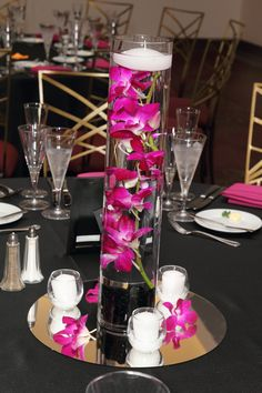 Orchids in water with a floating candle