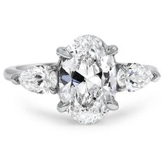 Pear-shaped diamond accents sit on either side of a dazzling oval-shaped center stone in this romantic claw prong setting.