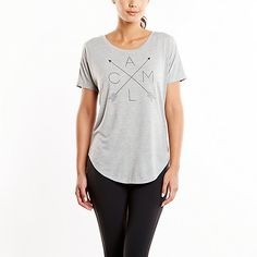 You'll love the easy wear and versatility of our Workout Tee. The wicking fabric and feminine scoop neck make this top a lucy favorite.