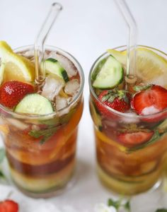 I love a delicious Pimm's Cup in the heart of summer! This was is topped with sparkling rosé wine and filled with strawberries, cucumbers and lemon wedges. It's super refreshing and perfect on hot hot days! I howsweeteats.com #pimms #cup #recipe #cocktails #rosé #sparkling #summer