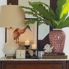 Perfect sample of using a variety of decorative accessories to create an interesting vignette. Beautiful!