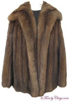 Royal Crown Russian Sable Jacket #RS616  $15,000; Approx. size estimate: 4 - 8 Petite or Average; Excellent condition. This is a very lavish genuine natural Royal Crown Russian sable fur jacket which has only been worn twice. It has a Frost Bros. label and features a large shawl collar. There are two-velvet lined exterior pockets and a pocket hidden in the lining. The lining is solid dark brown silk and there is NO MONOGRAM. It closes with hooks and eyes. There are silvery tips galore...
