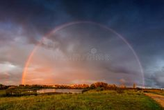 Photo about Countryside fall landscape with rainbow and dramatic rain sky. Lake visible and rural road. Image of colours, path, beautiful - 127593531 Fall Landscape, Images Of Colours, Portfolio Website, Children Clothes, Autumn Leaves, Countryside, Paths, Country Roads, Rainbow