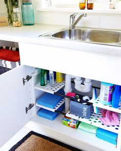 Under the sink Under the sink  An expandable shelf unit under the sink can be adjusted to suit your cabinet and allows space for the S-bend. It's easy to keep clean and will keep all your cleaning gear in order.