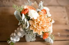A beautiful orange bouquet that's perfect for a fall wedding.