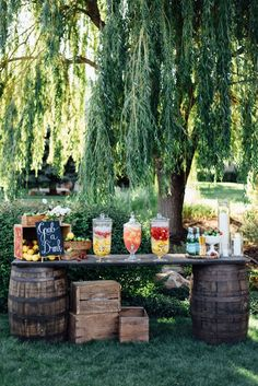 rustic drink station using whisky barrels + wooden crates.