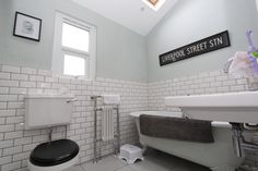 Bathroom, higher sloping ceiling than ours - bath and shower in same room, sink on opposite wall