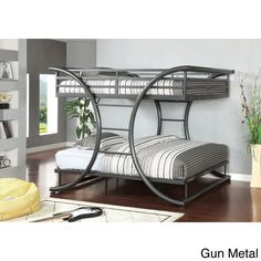 Decorate a room with this modern designed bunk bed without giving up more space than you need! This handy full over full bunk bed comes in two finishes to appeal to any home. Curved metal posts double as support and ladders so you can have it all in one!