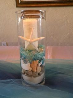 Beach themed DIY centerpieces--sand, rocks, colored rocks and candle Beach Themed Crafts, Beach Crafts, Sand Crafts, Nautical Home, Nautical Wedding, Beach Room, Beach Bathrooms, Shell Beach, Diy Centerpieces